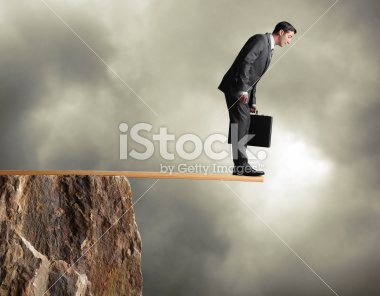 stock-photo-22238914-businessman-walking-the-plank